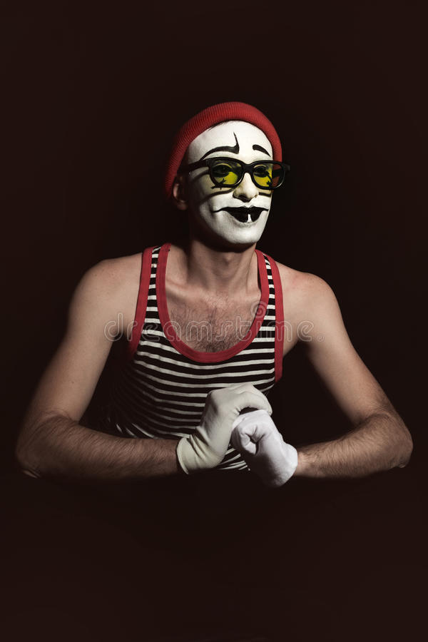 Portrait of mime wearing red hat and yellow eyeglasses stock photos