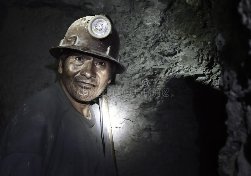 Portrait of a miner inside Cerro Rico silver mine, Potosi, Bolivia. Portrait of a miner inside Cerro Rico silver mine. October 8, 2012 - Potosi, Bolivia royalty free stock image