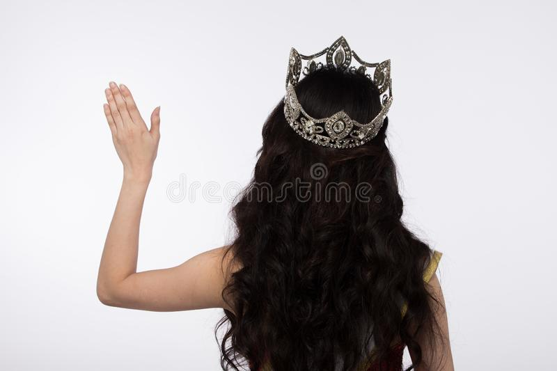 Miss Pageant Contest Evening Ball Gown dress Crown. Portrait of Miss Asian Pageant Beauty Contest in Red sequin Evening Ball Gown dress sparkle light Diamond stock photography