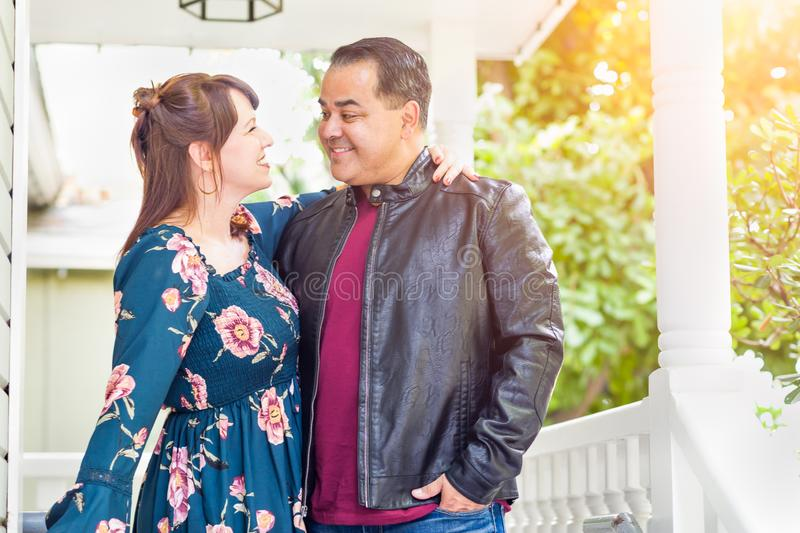 Amourous Mixed Race Caucasian Woman and Hispanic Man. Portrait of Mixed Race Caucasian Woman and Hispanic Man royalty free stock photography