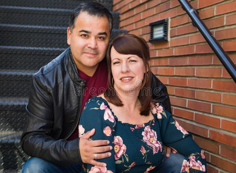 Portrait of Mixed Race Caucasian Woman and Hispanic Man. Posing in a Stairway stock photo