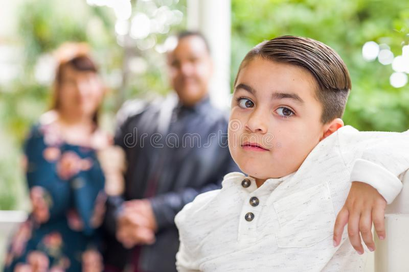 Mixed Race Couple Standing Behind Young Son stock photo
