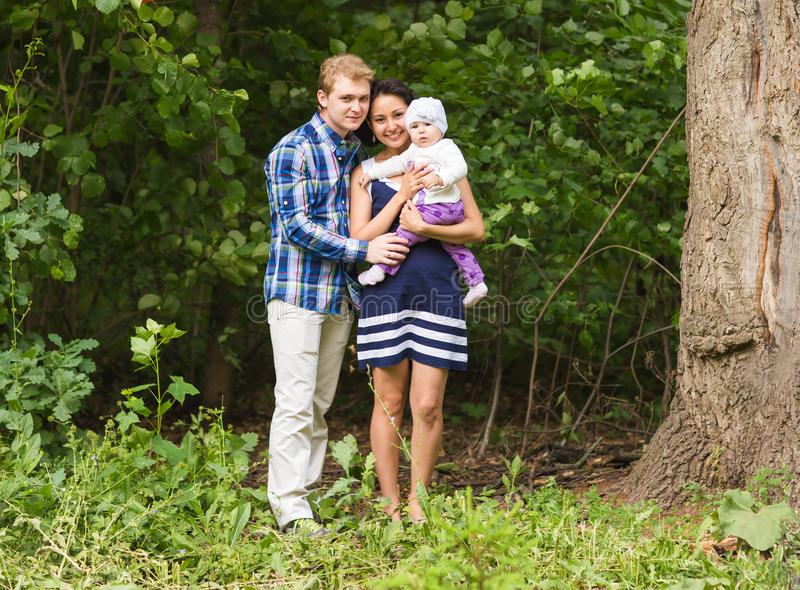 Portrait of mixed race family on nature royalty free stock image