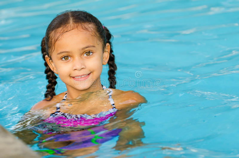 Portrait of mixed race girl in pool royalty free stock photo