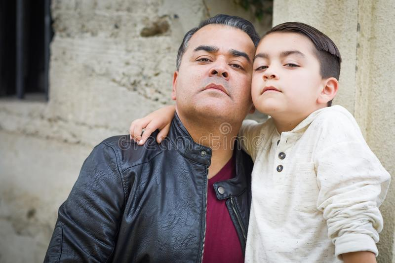 Serious Mixed Race Hispanic and Caucasian Son and Father. Portrait of Mixed Race Hispanic and Caucasian Son and Father stock photo