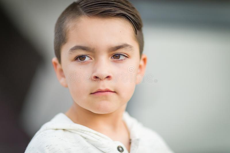 Serious Mixed Race Young Hispanic and Caucasian Boy. Portrait of Mixed Race Young Hispanic and Caucasian Boy royalty free stock image