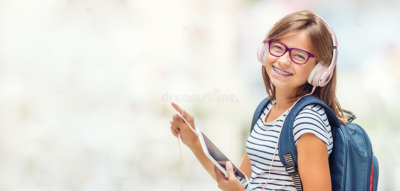 Portrait of modern happy teen school girl with bag backpack head royalty free stock images