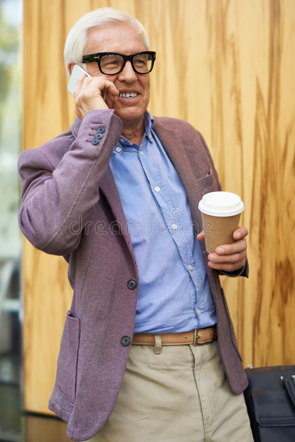 Contemporary Senior Man Speaking by Phone royalty free stock images