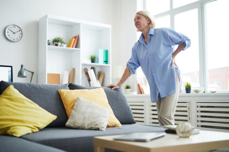 Mature Woman Suffering from Back Pain stock photo