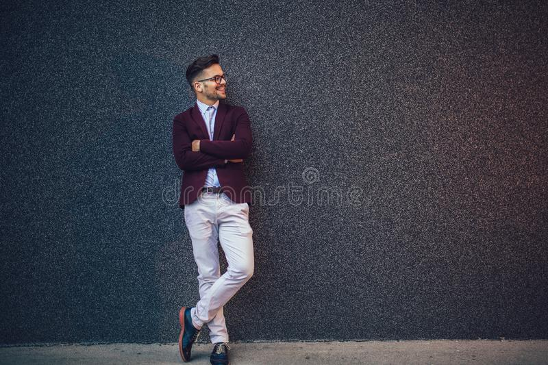 Modern young smiling businessman outdoor stock photography
