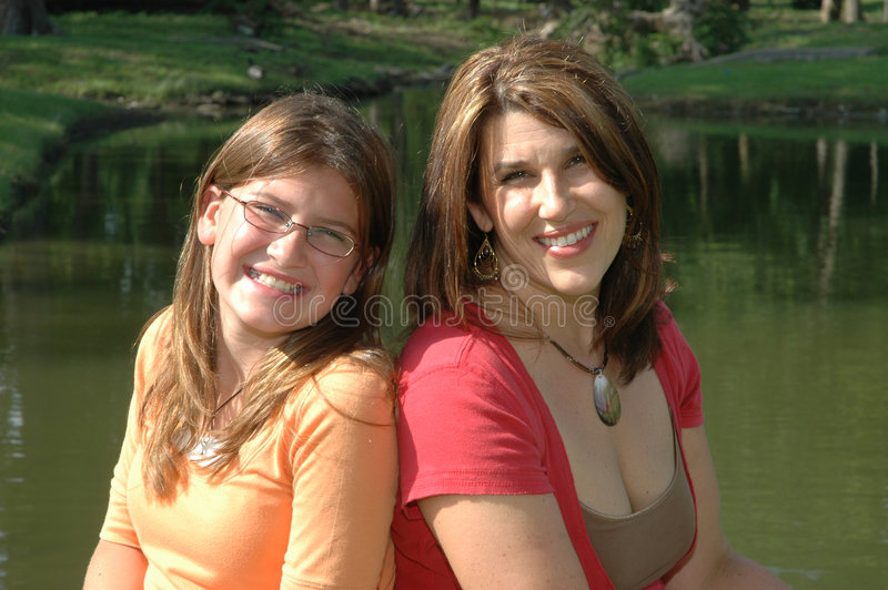 Portrait of mom and daughter stock images
