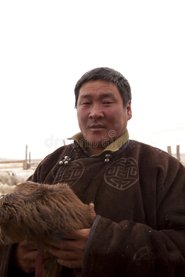 Download Portrait Of A Mongolian Herdsman With Baby Goat Editorial Photo - Image: 24773576