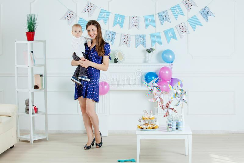 Portrait of mother and baby with birthday cake.  royalty free stock photo