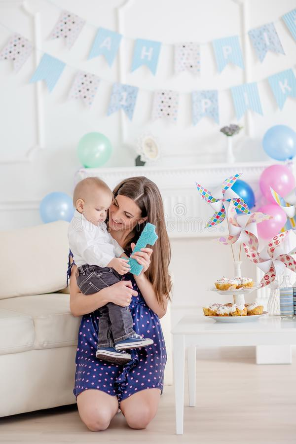 Portrait of mother and baby with birthday cake.  royalty free stock photography