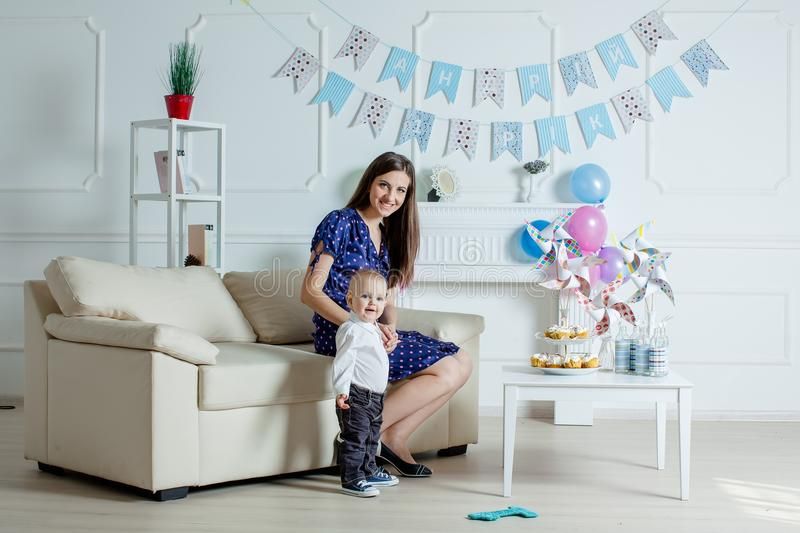 Portrait of mother and baby with birthday cake.  stock image