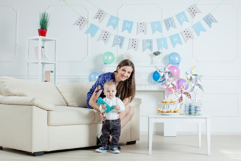 Portrait of mother and baby with birthday cake.  royalty free stock image