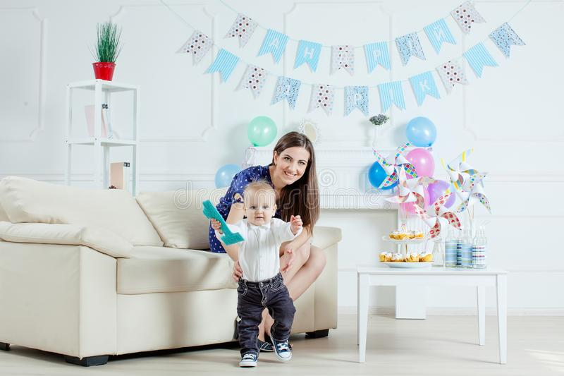 Portrait of mother and baby with birthday cake.  stock images