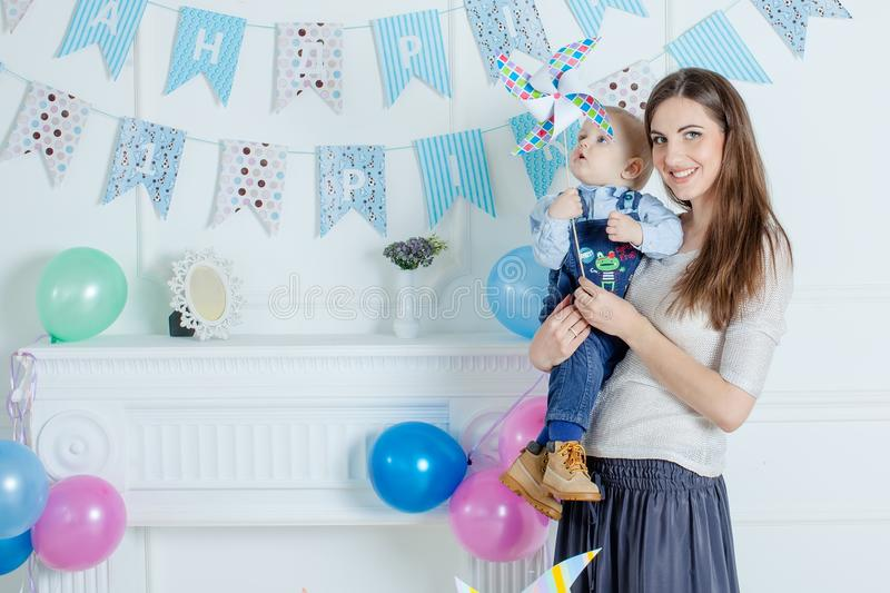 Portrait of mother and baby with birthday cake.  stock photos