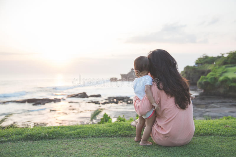 Portrait of mother and baby in sunset royalty free stock photography