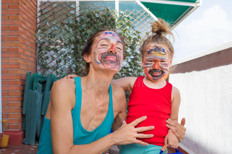 Portrait of mother and child with painted face looking royalty free stock images
