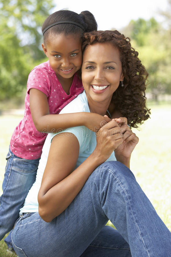 Portrait Of Mother And Daughter In Park. Smiling stock images