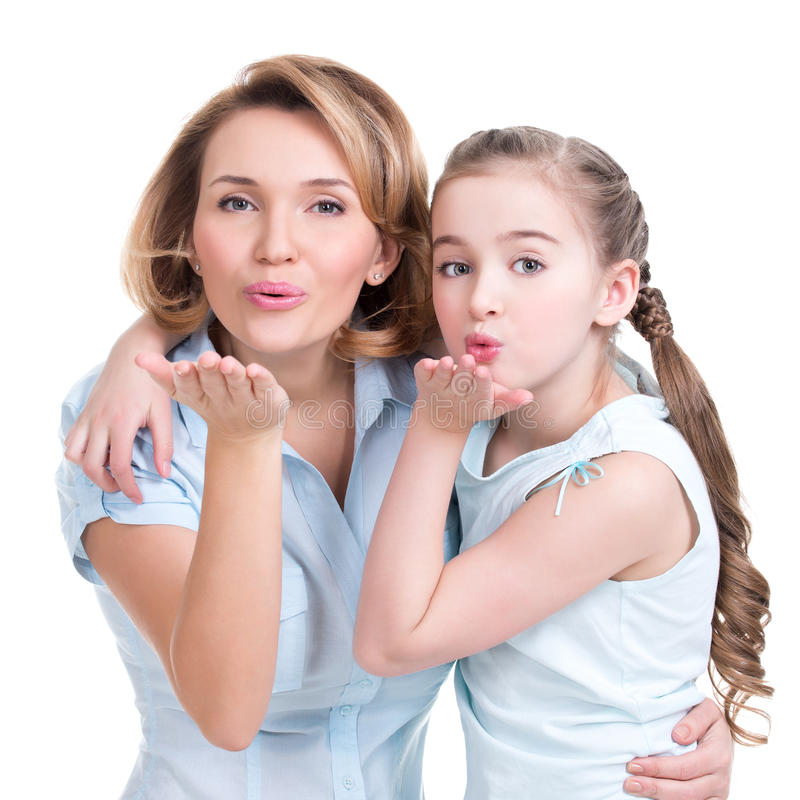 Portrait of mother and daughter send kisses. Studio shot on white stock photo