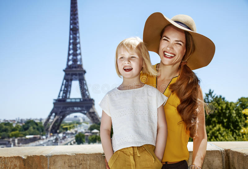 Portrait of mother and daughter travellers in Paris, France. Having fun time near the world famous landmark in Paris. Portrait of smiling mother and daughter royalty free stock photos