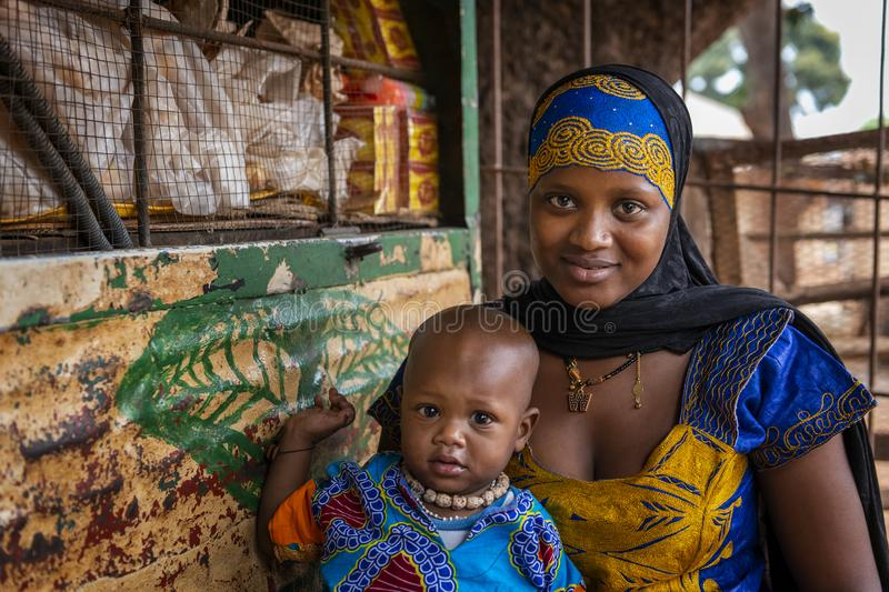 Portrait of a mother and her baby at the Missira neighborhood in the city of Bissau, Guinea Bissau. Bissau, Republic of Guinea-Bissau - February 6, 2018 stock photography