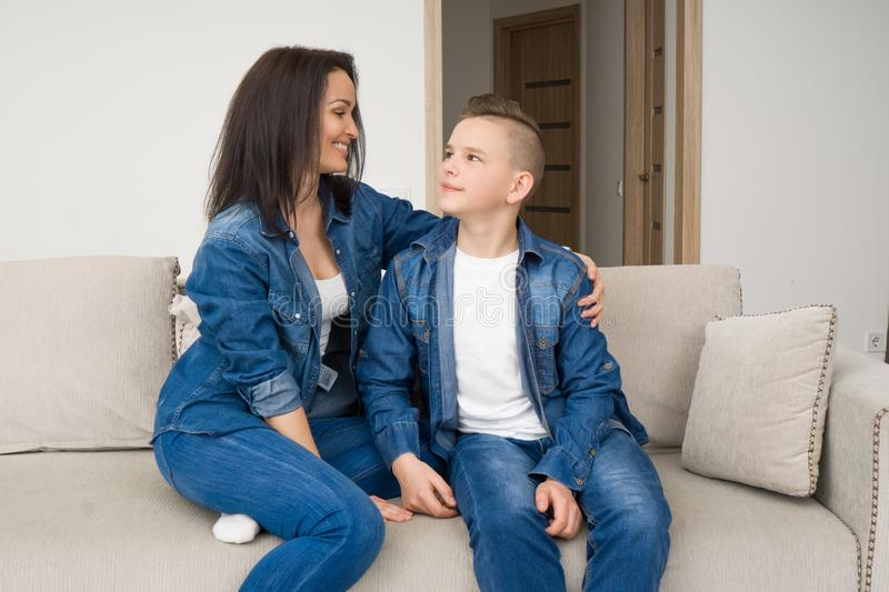 Portrait of mother and her son on sofa at home royalty free stock images