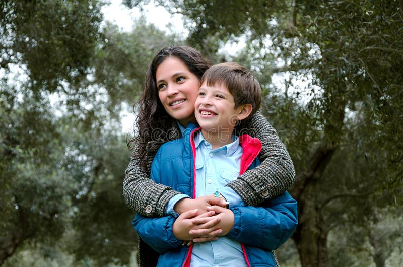 Portrait of a mother with her son teenager. Tenderness, love. royalty free stock photography