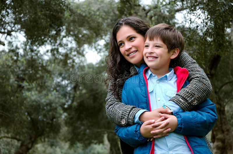 Portrait of a mother with her son teenager. Tenderness, love. stock photo