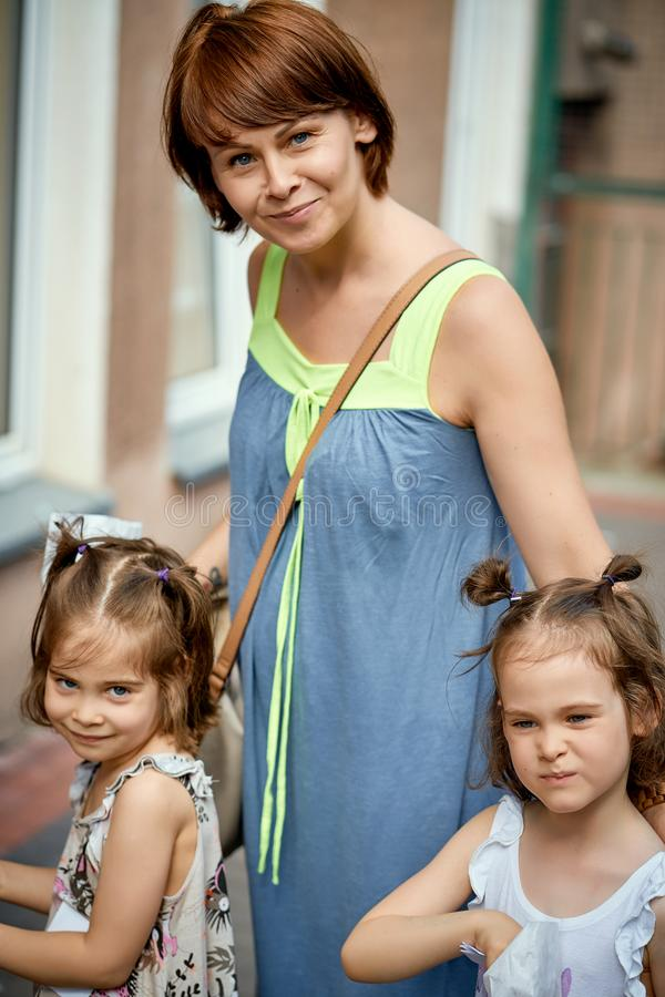 Portrait of mother and littles daughters at family picnic in the park. royalty free stock images