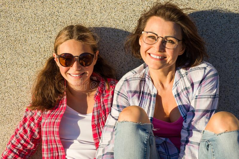 Portrait of mother nd daughter relaxing outdoors stock photography