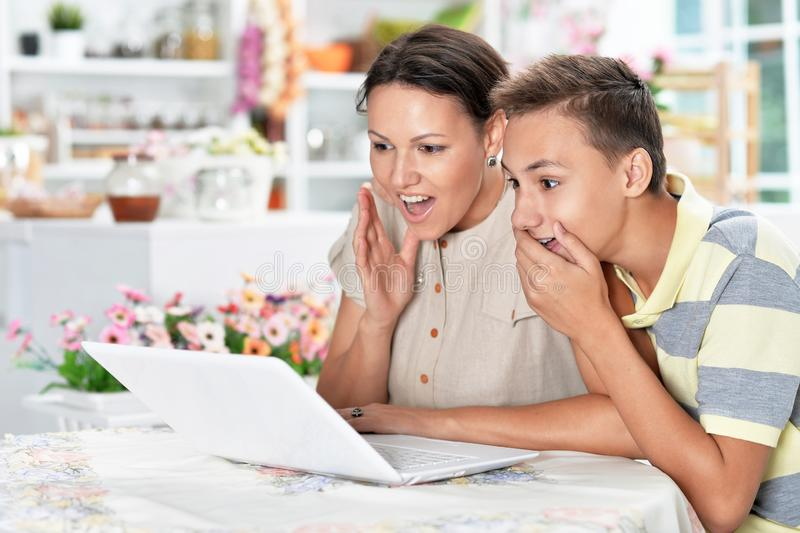 Portrait of mother and son using modern laptop royalty free stock photo