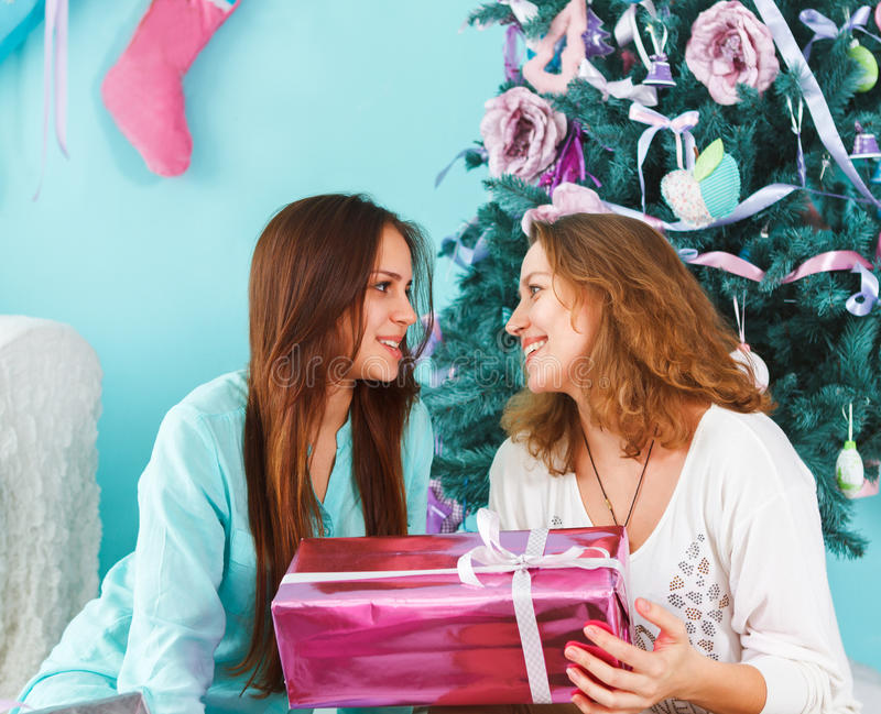 Portrait of a mother with teen daughter at home near the Christmas tree stock photography