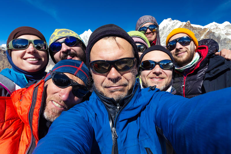 Portrait of Mountain Climbers Team happy to reach the Summit royalty free stock image