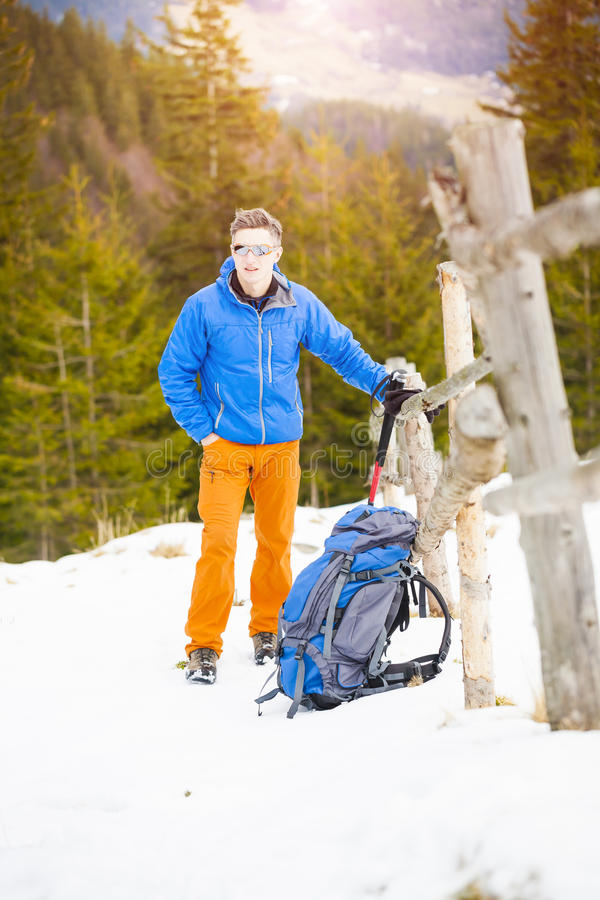 Portrait of a mountaineer with a backpack. royalty free stock image