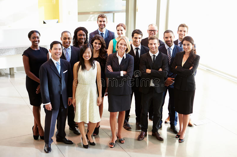 Portrait Of Multi-Cultural Office Staff Standing In Lobby. Looking At Camera Smiling stock images