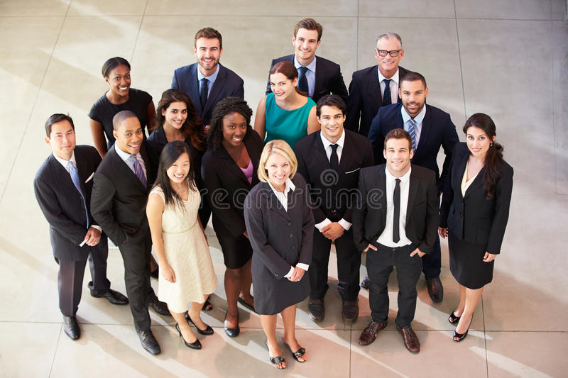Portrait Of Multi-Cultural Office Staff Standing In Lobby. Smiling At Camera stock photo