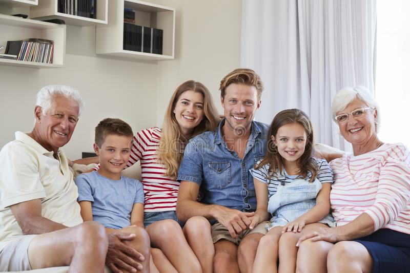 Portrait Of Multi Generation Family Sitting On Sofa At Home stock image