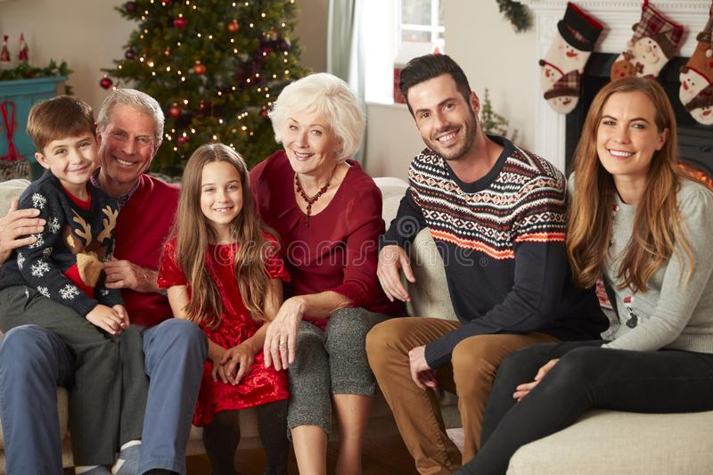 Portrait Of Multi Generation Family Sitting On Sofa In Lounge At Home On Christmas Day stock photos