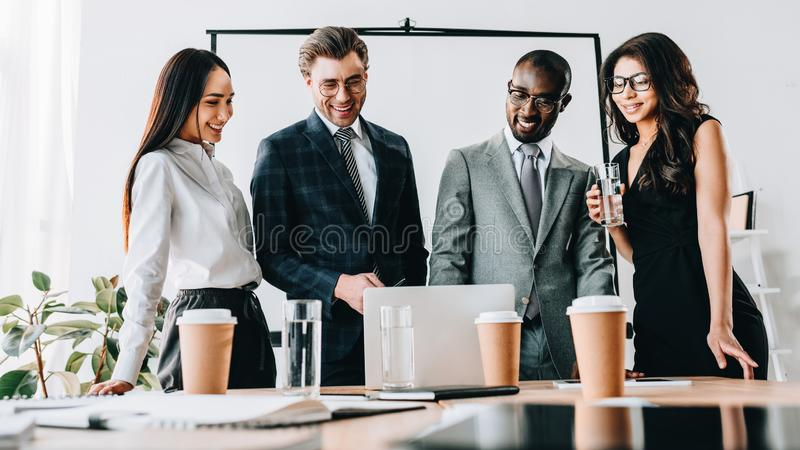 portrait of multicultural smiling business people having business meeting royalty free stock photography