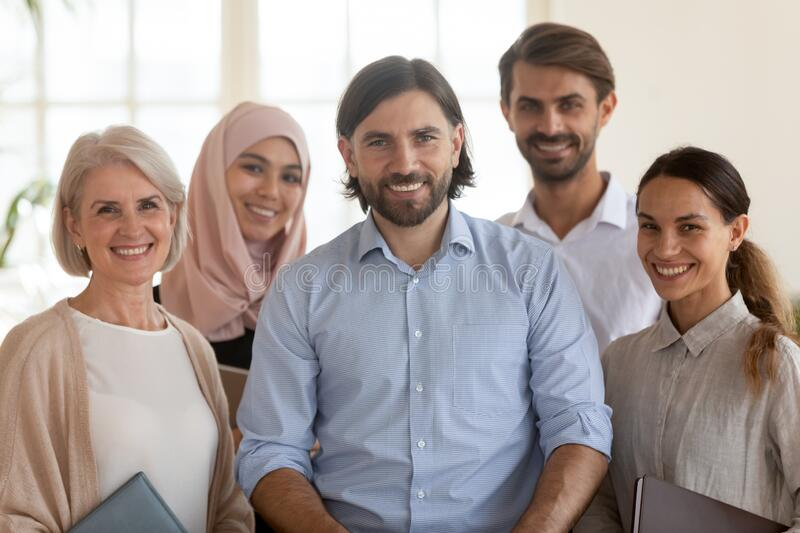 Portrait of multiethnic work team posing together in office royalty free stock photos