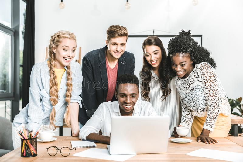 portrait of multiethnic young business team working stock photos