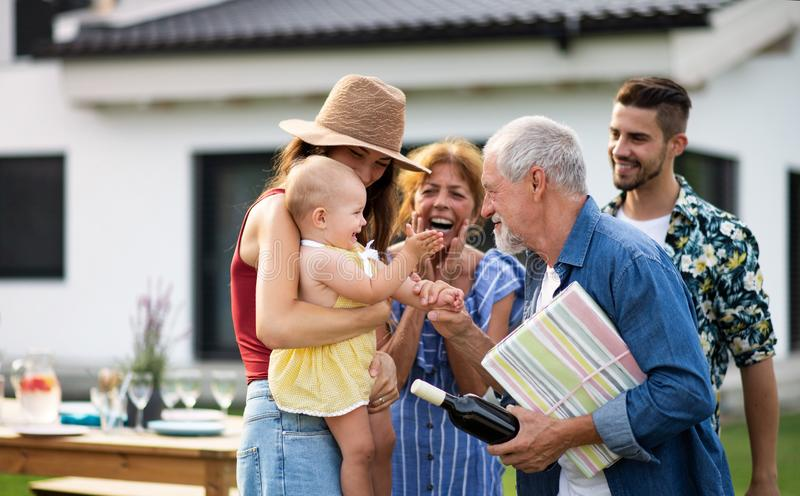 Portrait of multigeneration family outdoors on garden barbecue. royalty free stock photography
