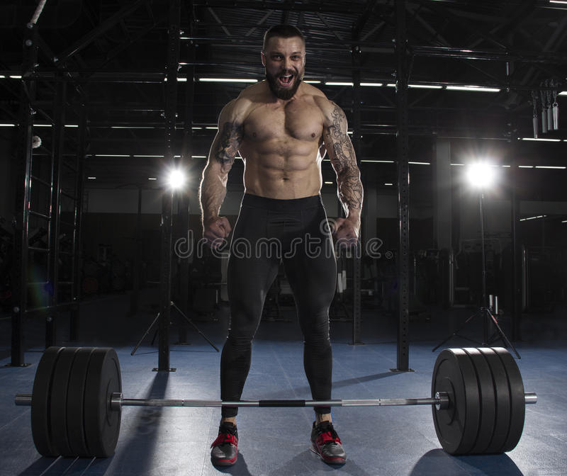 The portrait of muscular athlete celebrating his succesfull att stock images