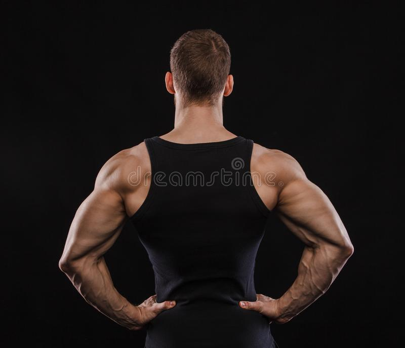 Portrait of a muscular male model against black background royalty free stock photo