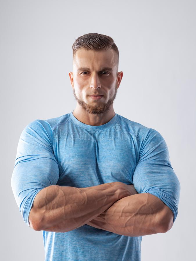 Portrait of a muscular male model on white background stock image