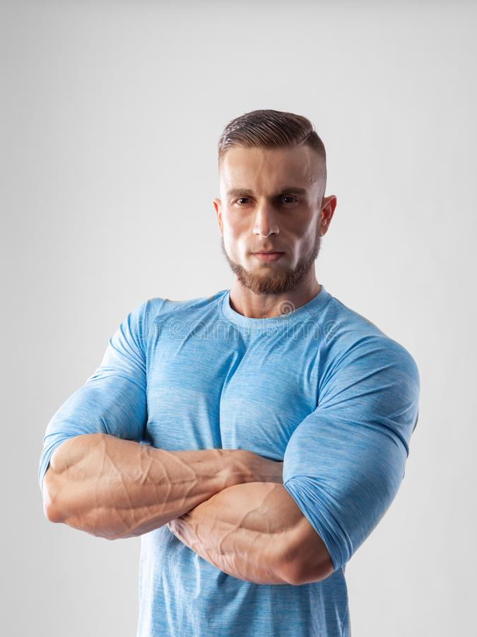 Portrait of a muscular male model on white background stock photos