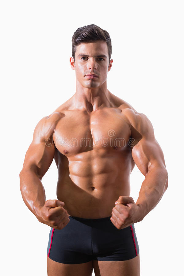 Portrait of a muscular man clenching fists royalty free stock image